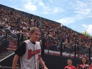 Freshman Ben Lepisto takes the turf at the spring pep rally. Lespisto had recently been diagnosed with a form of brain cancer. (Credit: Brian O'Halloran)