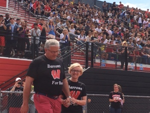 Ben's parents take the field at the spring pep rally. (Credit: Brian O'Halloran)