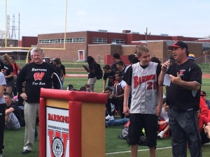 Coach Urbano discusses the Lace Up 4 Pediatric Cancer fundraiser at the spring pep rally as Ben Lepisto listens on. (Credit: Brian O'Halloran)