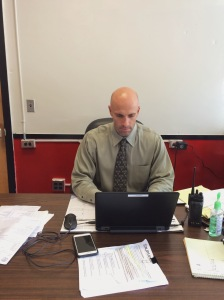 New Vice Principal Mr. Chiera completes his work at his desk. Previously a coach and a teacher at Colonia High School, he was appointed as V.P. over the summer. (Credit: Cassidy Ronk)